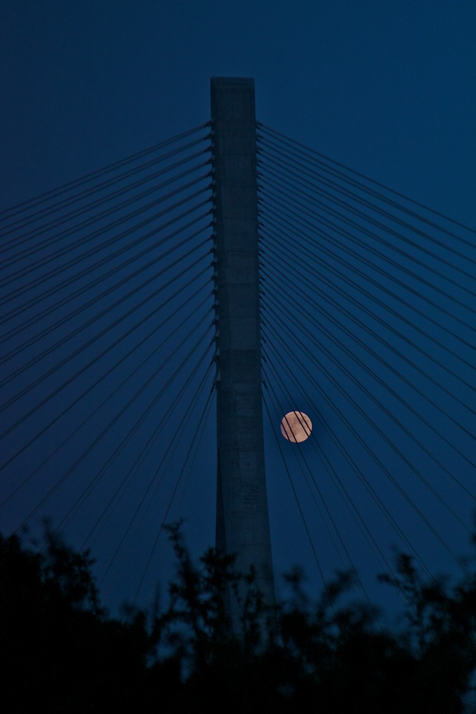 Moon as shot through suspension cables of N25 bridge in Waterford
