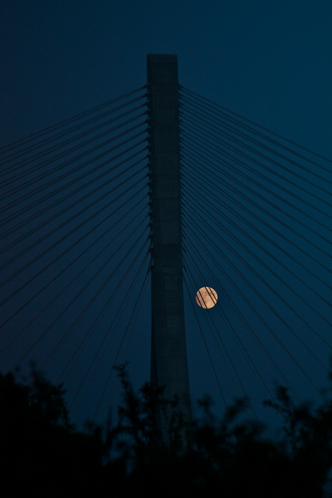 Moon shot through the suspension cables on the N25 bridge